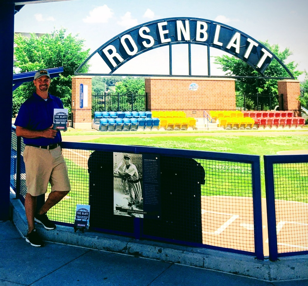 "Paul Fiarkoski poses with his book ""Romancing The Blatt"" at Omaha's Infield at the Zoo"